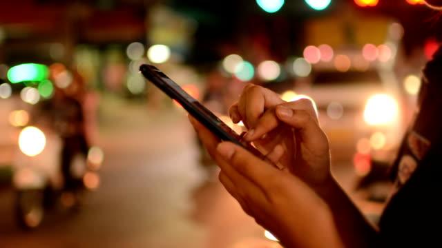 Women using smartphone, night
