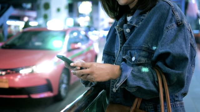 women using smartphone, night - rideshare stock videos and b-roll footage