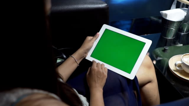 women using tablet phone with green screen video