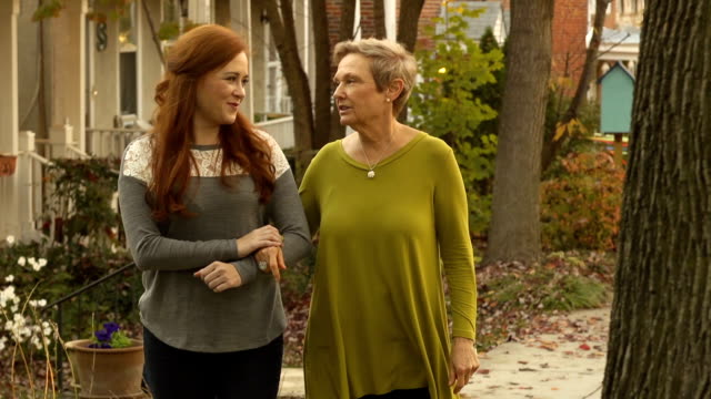 Women Walk Together in Neighborhood - Multi Clip video