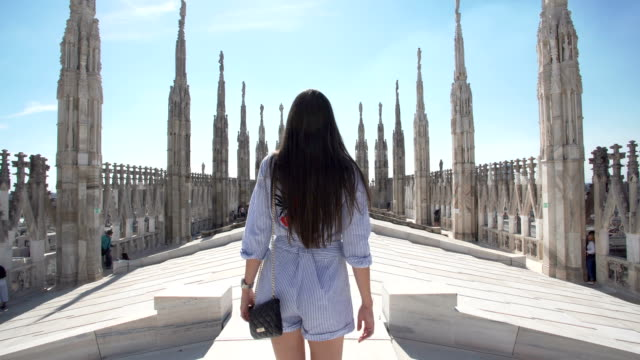 women walking at the milan cathedral - gothic architecture stock videos & royalty-free footage