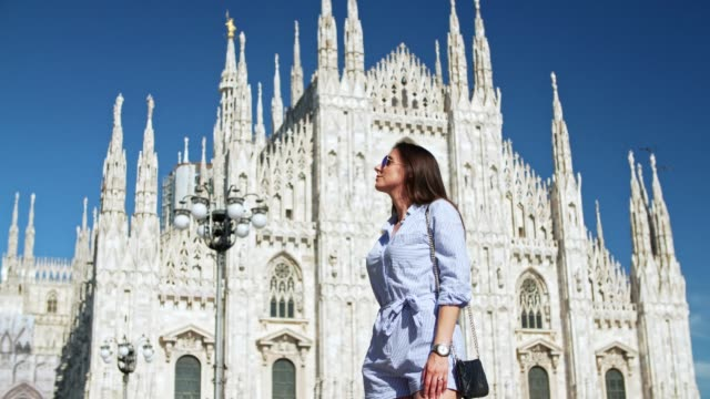women walking at the milan cathedral - gothic fashion stock videos and b-roll footage