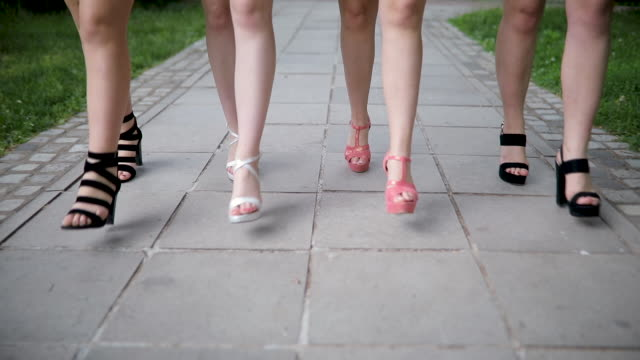 Women walking in high heels
