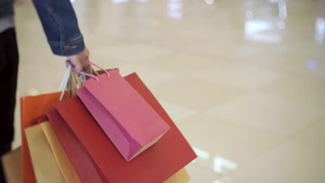 women walking in shopping mall, sale, consumerism: - shopping bags stock videos & royalty-free footage