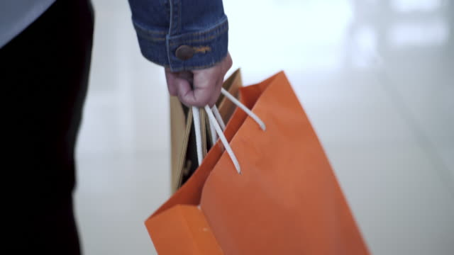 vídeos de stock e filmes b-roll de women walking in shopping mall, sale, consumerism: - tote bag