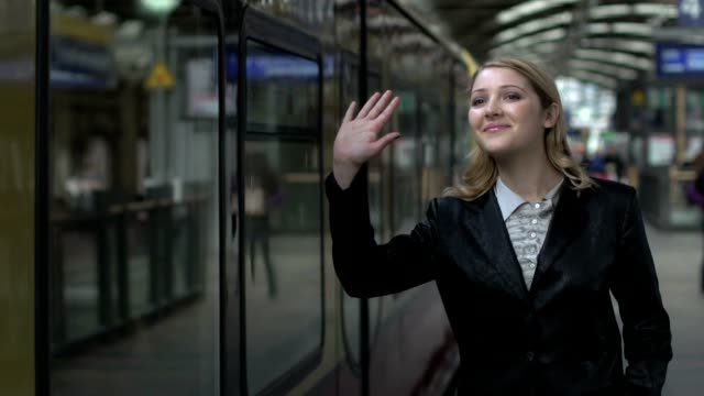 stockvideo's en b-roll-footage met women waving hand goodbye farewell - scheiding begrippen