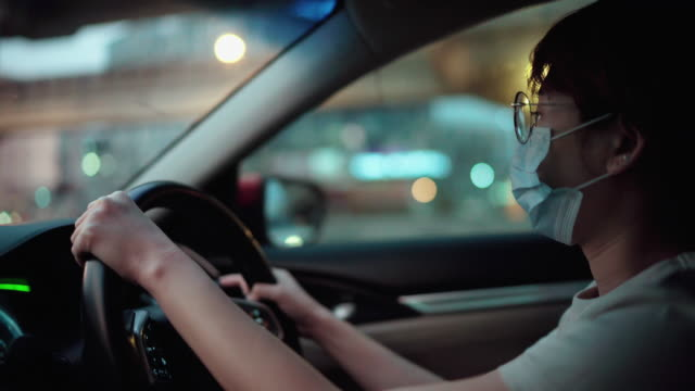 women wearing protective masks while driving - essential workers stock videos & royalty-free footage