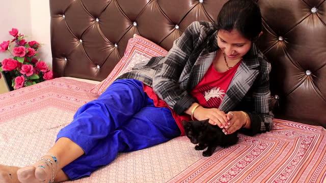 Women with black cat video