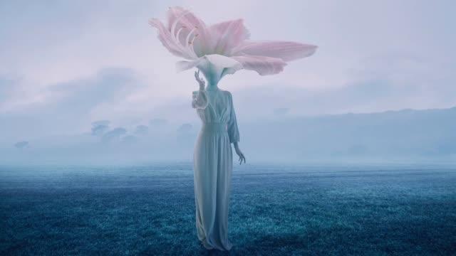 women with flower head - сюрреалистический стоковые видео и кадры b-roll