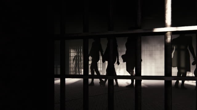Women's and small girl's silhouettes in prison with a prisoner inside his cell Convicted murderer with his thoughts - domestic violence prison bars stock videos & royalty-free footage