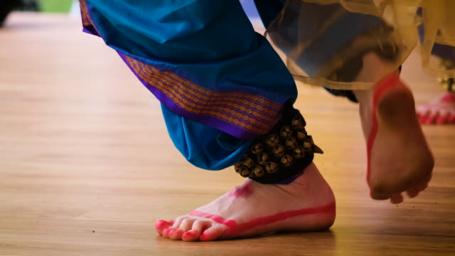 women's feet dancing Indian dance. women's feet in Indian national dress dancing on stage. slow motion 4kUHD sari stock videos & royalty-free footage