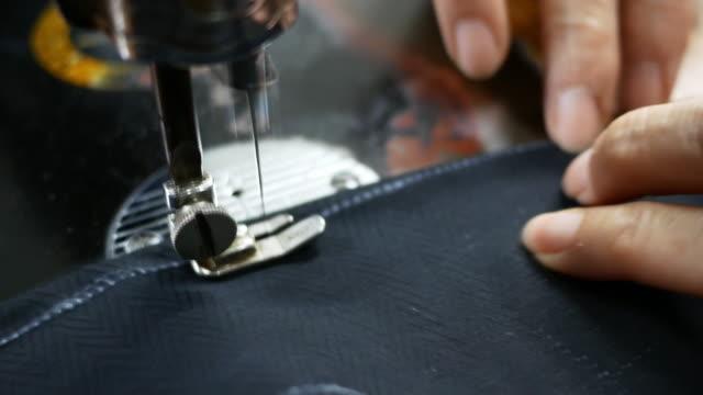 Women's hands behind her sewing video