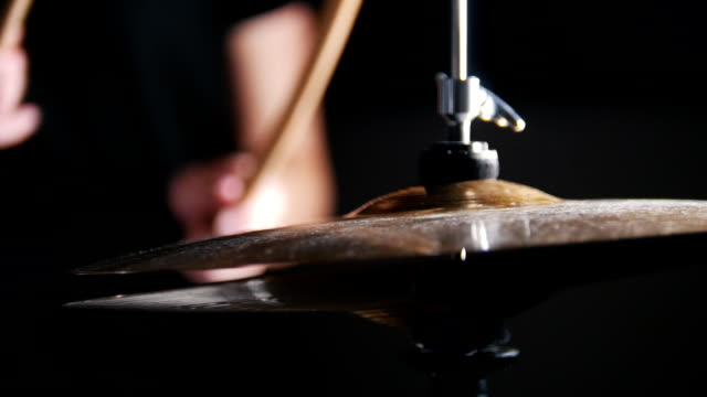 women's hands holding sticks and beat the drums - rotolare video stock e b–roll