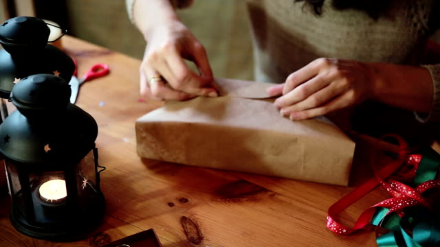 Women's Hands Wrapping Christmas Gifts At Home Young Woman Wrapping Christmas Gifts With Brown Paper At Home wrapped stock videos & royalty-free footage