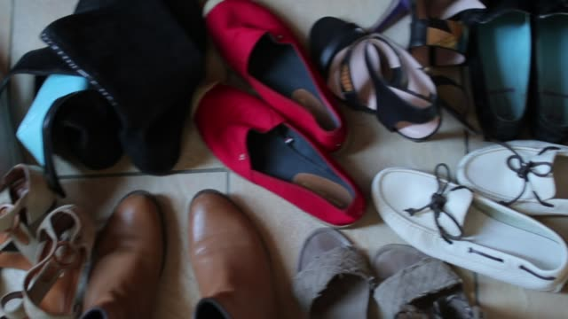 women's shoes are placed on the floor, close-up many pairs of shoes placed on the floor, close-up shoe stock videos & royalty-free footage