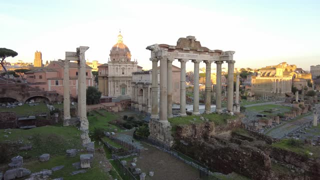 Wonderful panoramic sunset in ancient Roman Forum with ruin of famous Temple and building