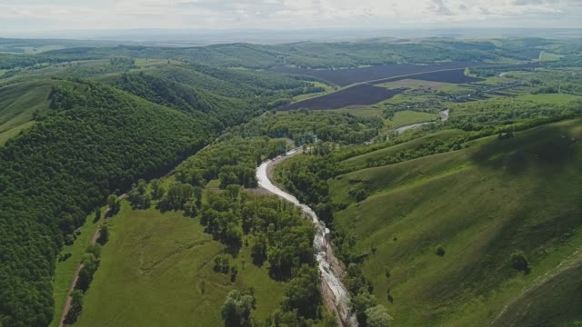 wonderful view of a mountain river at the foot of the mountains. aerial view. - quadcopter filmów i materiałów b-roll