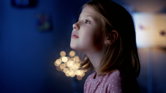 wondrous girl serenely looks out of the window. - curiosità video stock e b–roll