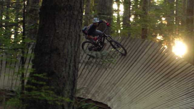 Wood Berm Wall Mountain Bike Shot Slow Motion at Golden Hour
