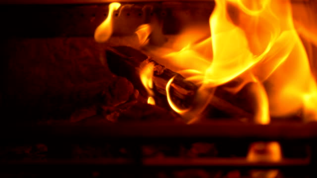Wood Burning in Fireplace Close up of wood on fire in a fireplace at home. Shot in slow motion. wood texture stock videos & royalty-free footage