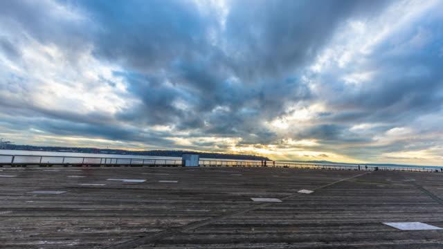 wood floor near sea in cloud sky.timelapse 4k