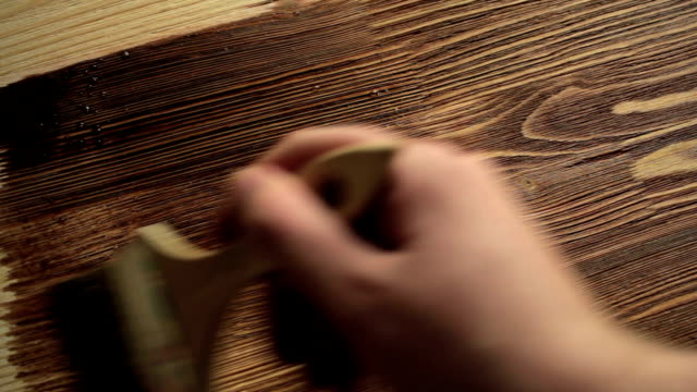 Wood painting with a brush with the brown color video
