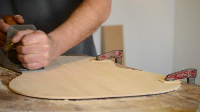 Wood planer working in flamenco guitar video