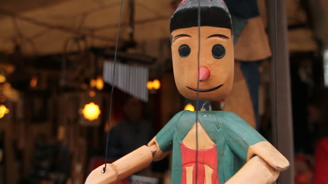 Wood puppet Sculpting of a wood puppet marionette stock videos & royalty-free footage
