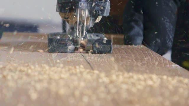 wood saw closeup - segatura video stock e b–roll