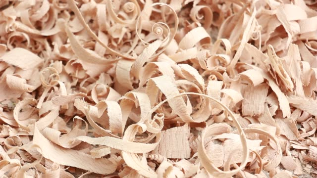 wood shavings - slow panning footage - segatura video stock e b–roll