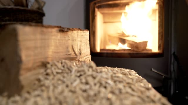 wood stove economical heating system video footage 4k - granula filmów i materiałów b-roll