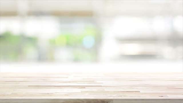 wood table top on blur kitchen window background - kitchen room video stock e b–roll
