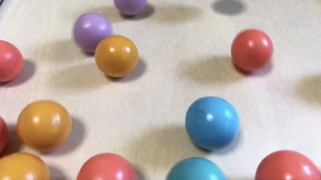Wooden balls are small from the developmental toys that ride on the table from top to bottom.