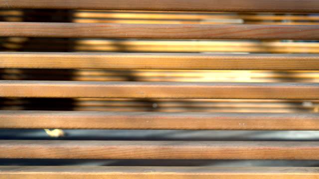 träbalk panorering. trä plankor vertikal panoramautsikt. bakgrund av persienner. - solar panel bildbanksvideor och videomaterial från bakom kulisserna