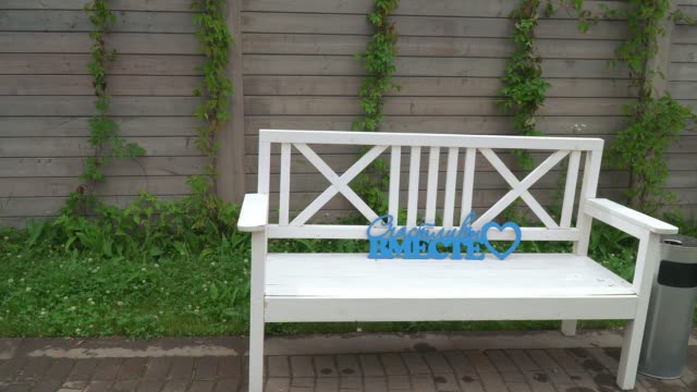 wooden benches with inscriptions for photographing - lingua russa video stock e b–roll