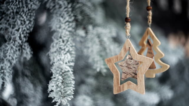 wooden christmas toys on snow-covered fir in winter park video