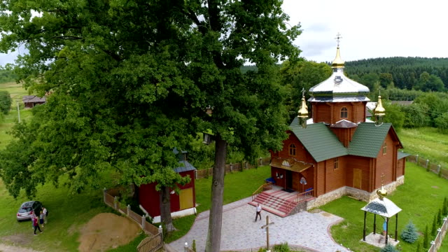 wooden church Ukraine Lviv 15.07.2018 aerial view move up 50p