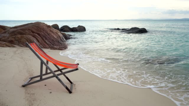 wooden comfortable chair on the beach clear sky and beautiful sea