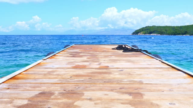 Wooden deck by the sea Floating pier in Corfu, Greece jetty stock videos & royalty-free footage