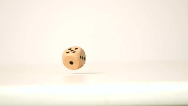 Wooden dice falling and bouncing video