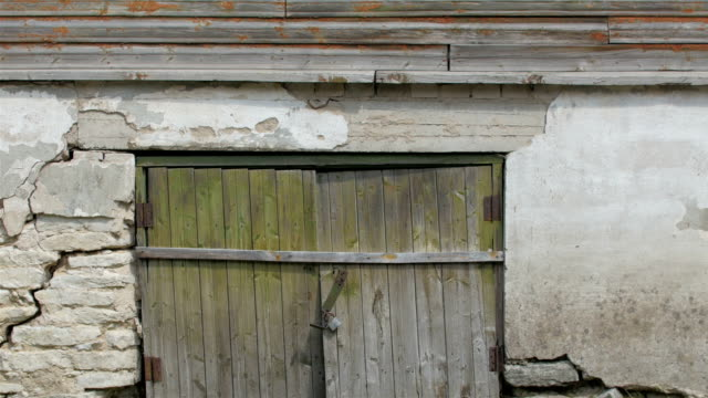 A wooden door of an old house video