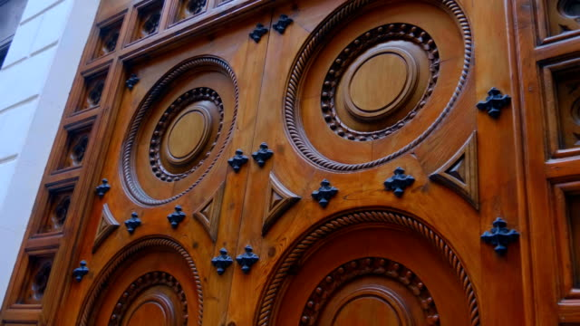 Wooden expensive with a beautiful pattern door to enter the house in the city