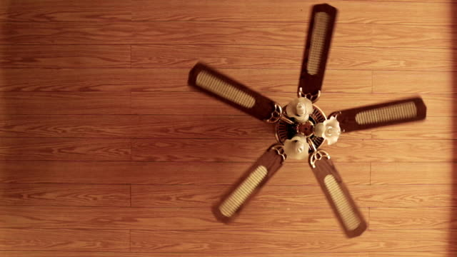 wooden fan with lamps hanging from the wooden ceiling. - soffitto video stock e b–roll