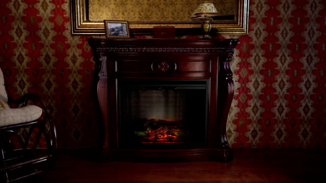 Wooden Fireplace in Conservative Interior Wooden Electronic Fireplace in Conservative Interior living room stock videos & royalty-free footage