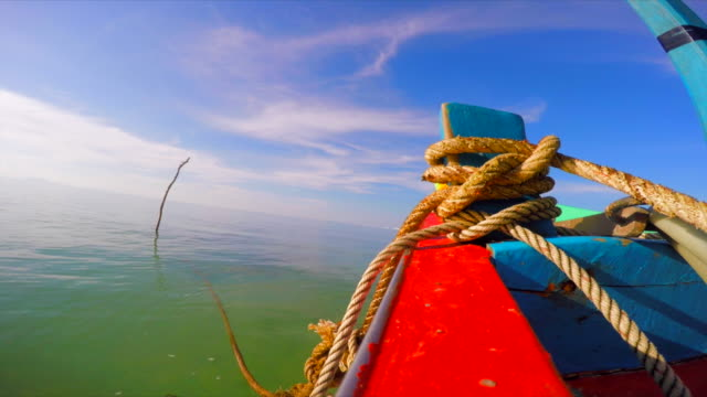 Wooden fishing boat in the sea with a big sea knot, view from the boats railing video