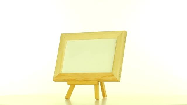 wooden frame on a white background - fotoram bildbanksvideor och videomaterial från bakom kulisserna