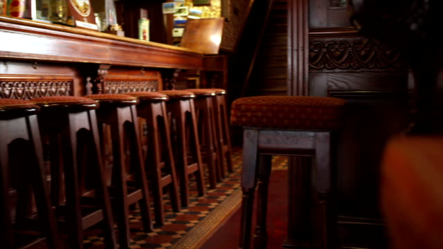 wooden furniture in the pub - bar i̇çkili mekan stok videoları ve detay görüntü çekimi
