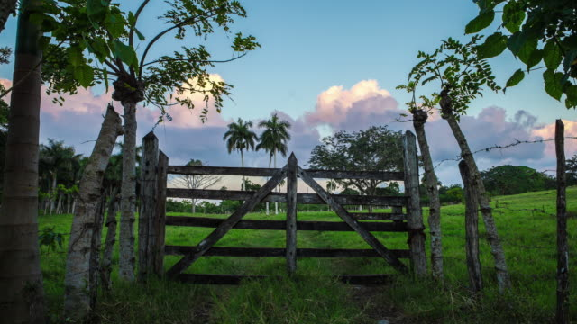 Wooden gates with a beautiful cloudy timelapse in background video