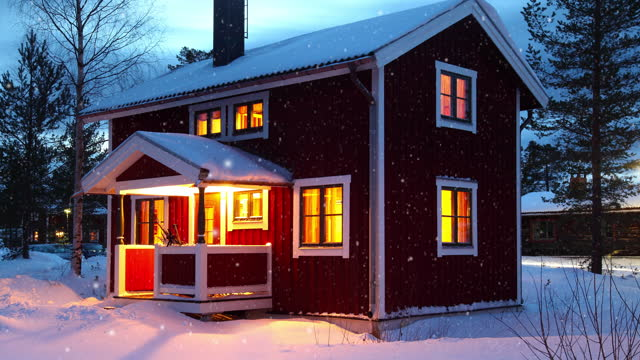 wooden house in Sweden during winter by night video