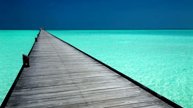 Wooden jetty over lagoon in Maldives with amazing clean water video